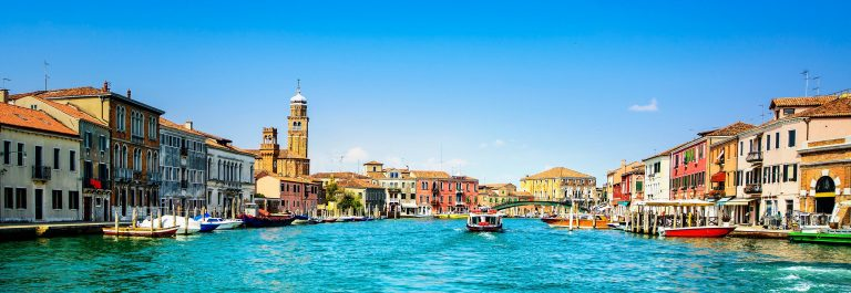 Murano glass making island, water canal and buildings. Venice, I