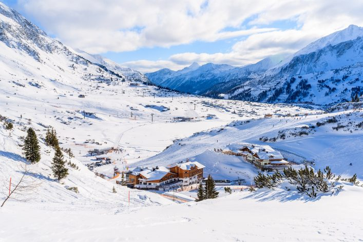 View of mountain huts covered with fresh snow in Obertauern winter resort, Austria shutterstock_566197993