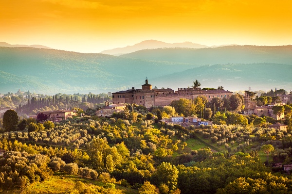 Tuscany Country Scenic Landscape of Vineyard and Hill Town Siena Italy iStock_000075361613_klein