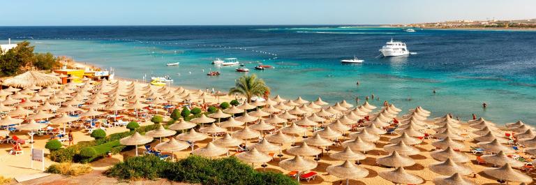 Umbrellas on the beach, Makadi, Egypt shutterstock_344501414