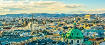 Aerial-view-of-Vienna-with-tower-of-the-town-hall-building-shutterstock_545763607-2-768×335