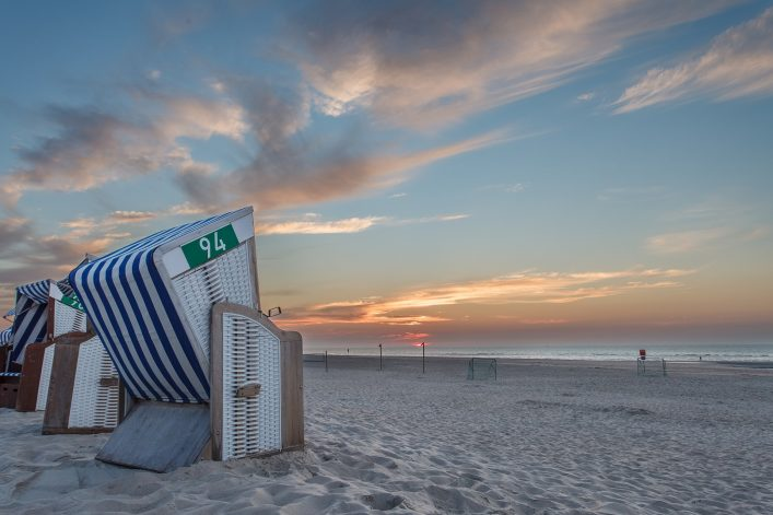 Beach chair in the sunset on the island of Norderney in the Germ shutterstock_687147136