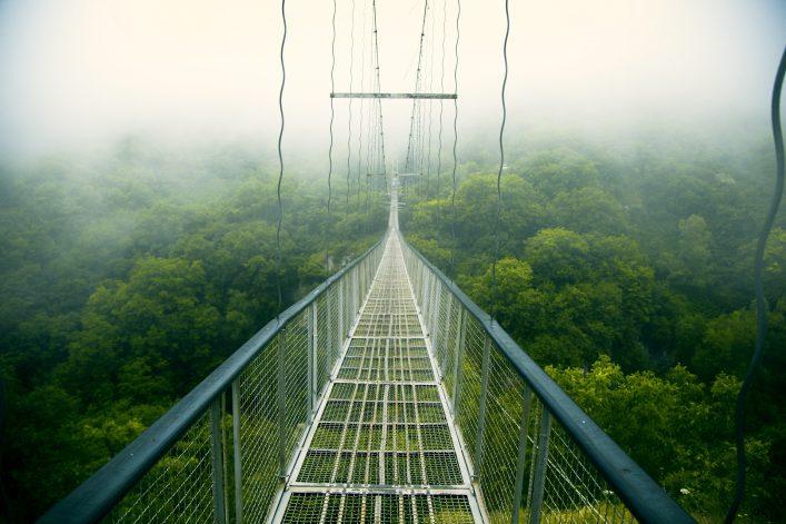 Khndzoresk Swinging Bridge. Suspension bridge over the gorge near Goris village shutterstock_696136267