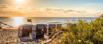 Strand-am-Morgen-Ostsee-iStock_000085022369_Large-2-768×335