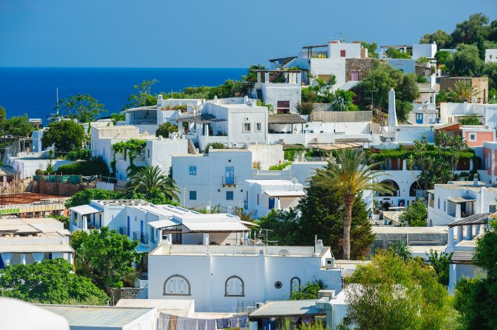 An above view of Panarea island with typical white houses, Aeolian islands, Sicily, Italy shutterstock_408112246