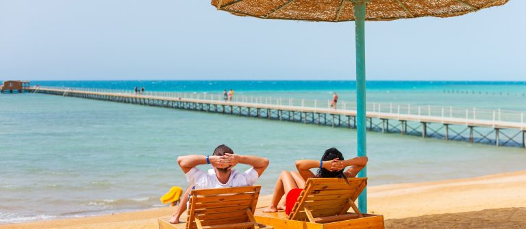 Relax of loving couple on the beach at Red Sea