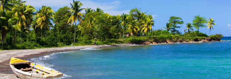Jamaica. A national boat on sandy coast