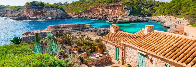 Beautiful view of the coast from Majorca island and beach Cala S Almunia, Spain Mediterranean Sea. shutterstock_533548117