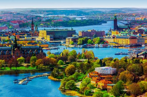Scenic summer aerial panorama of the Old Town (Gamla Stan) architecture in Stockholm, Sweden_shutterstock_191780339-2