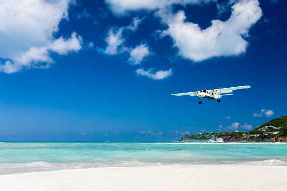 plane landing on the very short runway of Gustaf III Airport in Saint Barthelemy